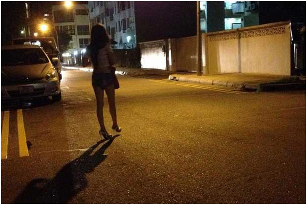 Girl Walking At night on Road Side For Customer